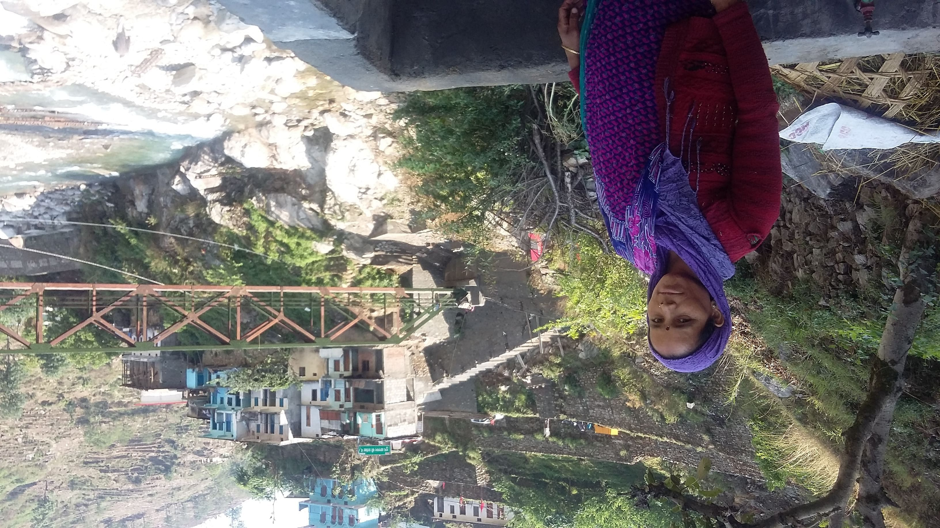 Although Vimla has managed to rebuild her home and the shop she is still waiting for the bridge (in the background) that connects the two to be repaired. (Credit: Nitin Jugran Bahuguna\WFS)