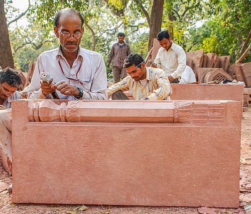 Skilled craftsmen working with traditional tools and materials