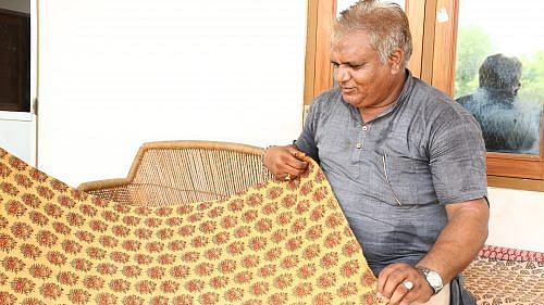 Lalchandji with his most prized possession, a print that won him a National award