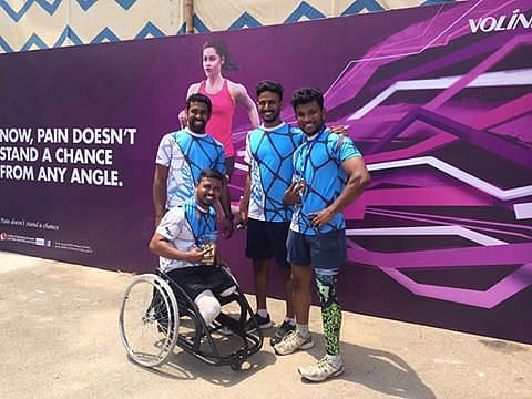 Arun Cherian, top left, with his sporty team that looks beyond disability