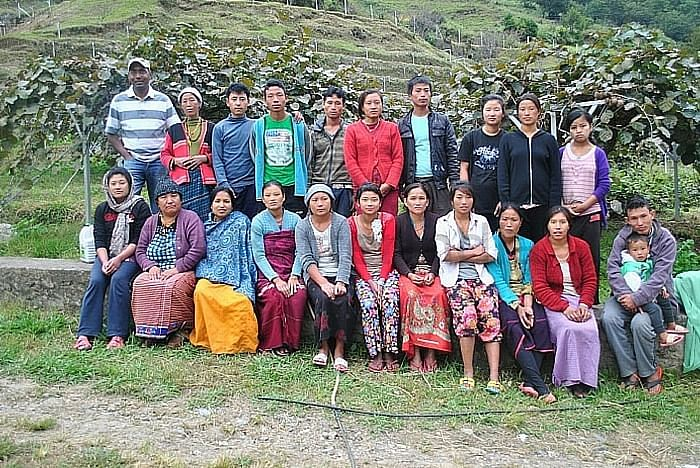 Puneet with a group of farmers in Dirang, Arunachal Pradesh after a week of kiwi fruit harvesting and packing. Image courtesy: Crop-Connect