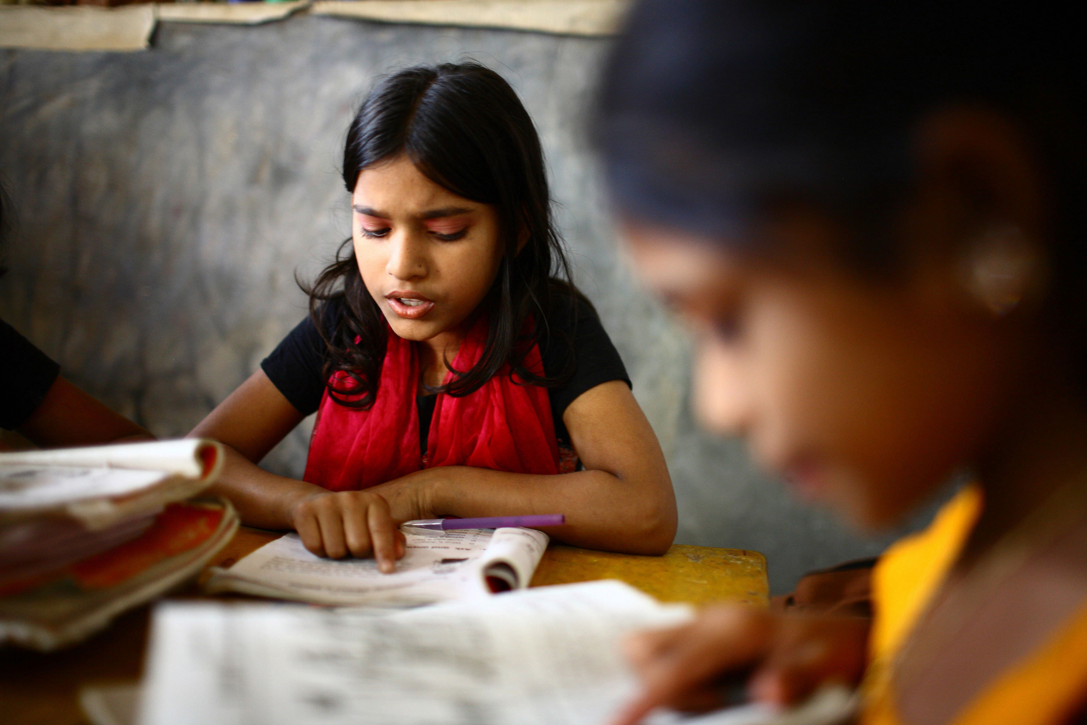 10 years old Dipa and 12 years old Laboni study in class two at Studying at UNIQUE CHILD LEARNING CENTRE. Mirpur