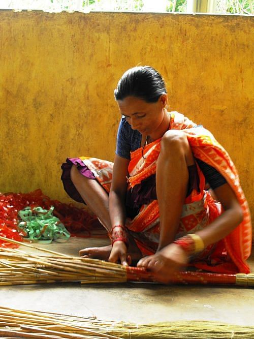 Tribal women in Kashipur have been making brooms to run their homes for generations. (Credit: Abhijit Mohanty\WFS)
