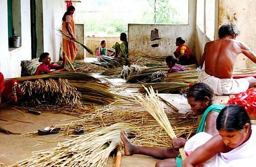 Women members of Ama Sangathan get together to make the brooms. (Credit: Abhijit Mohanty\WFS)