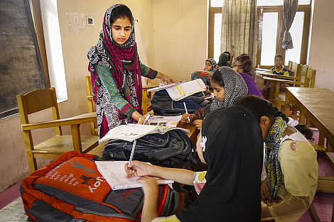 """Masarat Khan has joined hands with other like-minded girls to run a """"curfew school"""" in downtown Srinagar. (Credit: Baseera Rafiqi\WFS)"""