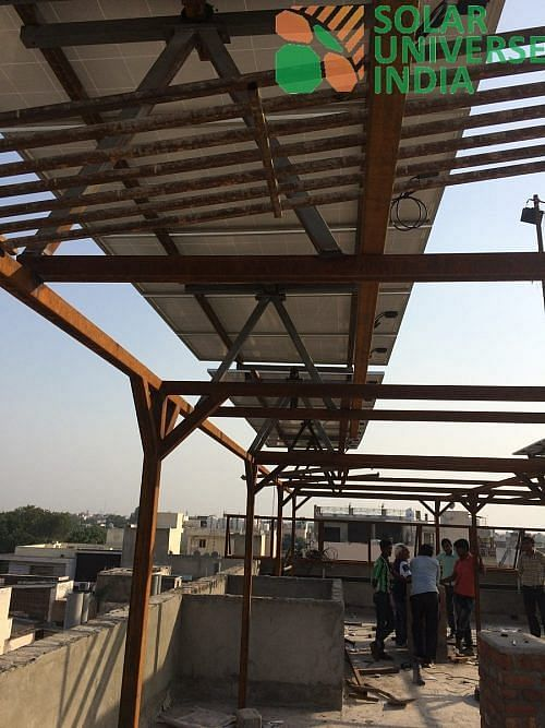 Solar Panels atop a super structure thereby freeing up roof space
