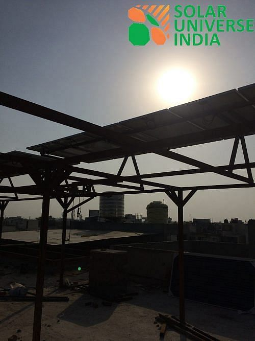 Sun Shine brights atop a Solar System erected on top of an elevated structure from ground level